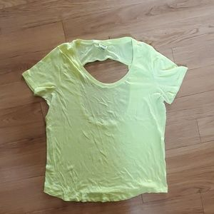 PINK. Bright yellow open back tshirt.  Size L